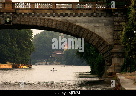 Turin the river Po with a view on the ponte Umberto I and the Borgo Medioevale in the Valentino parque - Stock Photo