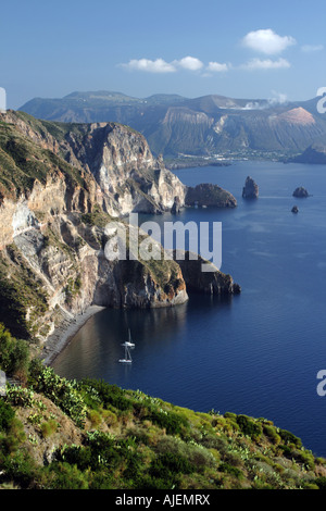 View from Quattrocchi over the steep coastline of Lipari in the Aeolian Islands, with the island of Vulcano in the - Stock Photo