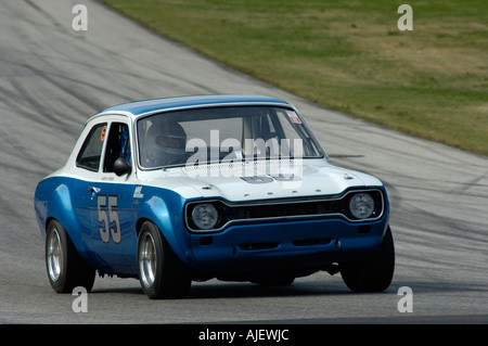 Karen Perrin races her 1969 Ford Escort RS1600 at the 2006 Kohler International Challenge with Brian Redman at Road America