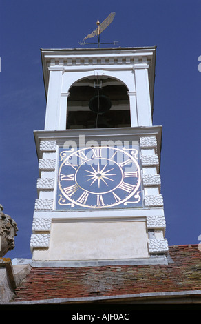 Clock and sundial on the tower of a renovated Church at Chislehampton Oxfordshire England - Stock Photo