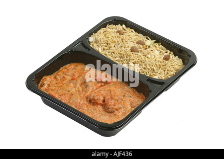 Microwaved curry in a plastic tray om a white background - Stock Photo