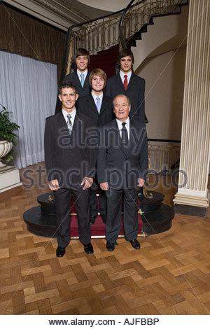 Male family members in suits - Stock Photo