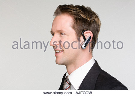 Businessman using hands free device - Stock Photo