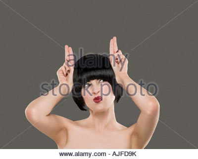 Woman grimacing and making hand gestures - Stock Photo
