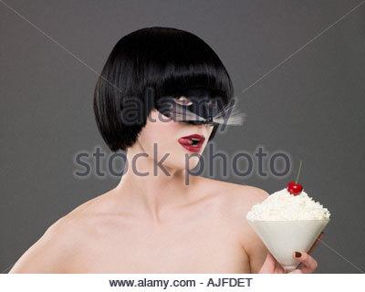 Woman wearing a costume mask - Stock Photo