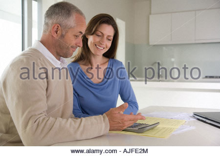 Couple working out bills - Stock Photo