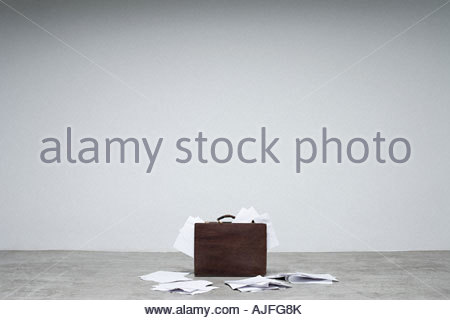 A briefcase and papers - Stock Photo