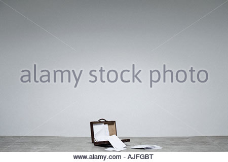 An open briefcase and papers - Stock Photo