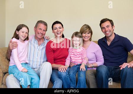 Three generation family on sofa - Stock Photo