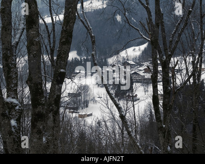 French Alps at roadside side at Megeve France looking through trees . A snowscape taken at roadside on way to Megeve - Stock Photo