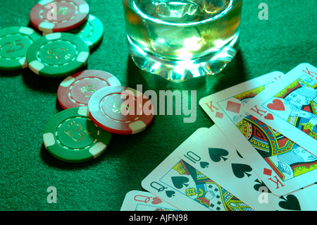 a poker hand including two pairs in a casino with gambling chips - Stock Photo