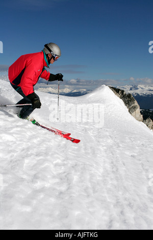 Back country skiing and snowboarding during cat ski and heli ski trips in the Whistler British Columbia area - Stock Photo