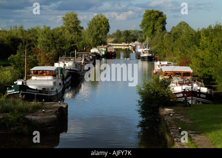 River Saone in the Cote D'Or France Boats on an Old Canal Lock at St Jean de Losne near Dijon - Stock Photo