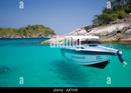 Speed boat appears to hang in clear blue tropical water Similan Islands Thailand - Stock Photo