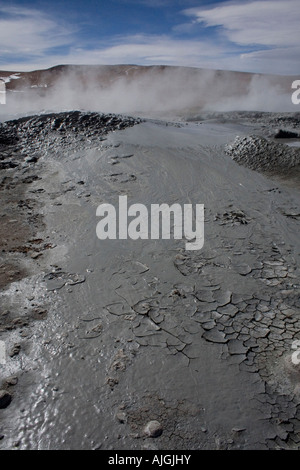 Boiling and mud of the Sol de Manana geysers, Bolivia - Stock Photo