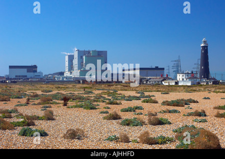 Dungeness Nuclear Power station Kent and Old disused lighthouse view from beach - Stock Photo