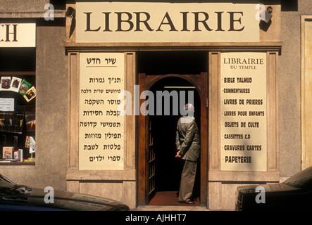 Jewish man, bookstore, bookshop, bookseller, book dealer, new and used books, Rue Vieille du Temple ,Marais district, - Stock Photo