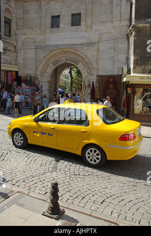 Istanbul taxi cab outside the entrance to the Grand Bazaar - Stock Photo