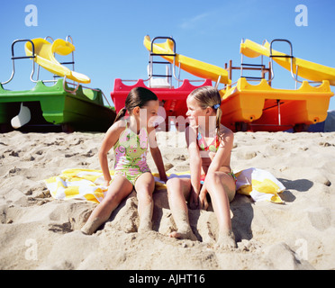 Two girls on the beach - Stock Photo