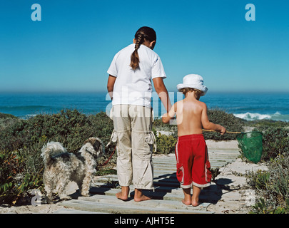 Brother and sister going to the beach - Stock Photo