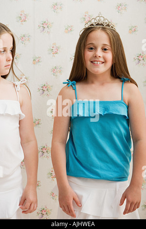 Girl looking jealously at her sister - Stock Photo