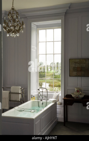 Bathroom with wood panelled walls and chandelier in Irish castle - Stock Photo