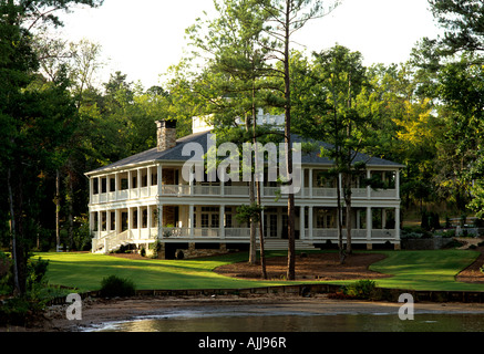 Southern style clapboard new build with veranda on shore of Lake Oconee, near Atlanta Georgia, USA - Stock Photo