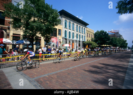 BIKE RACE IN THE HISTORIC ST. ANTHONY MAIN AREA ALONG THE MISSISSIPPI RIVER IN MINNEAPOIS, MINNESOTA. SUMMER. - Stock Photo
