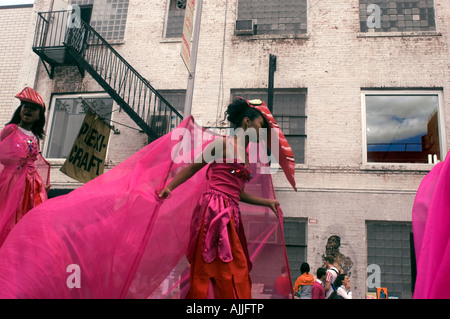 Costumed performers participate in a street performance Jumbie Camp - Stock Photo