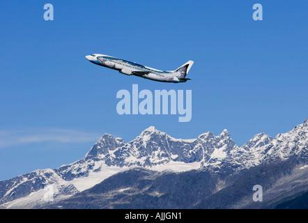 AK Airlines Salmon Jet over Mendenhall Glacier Coast Mtns Southeast Alaska Composite Autumn - Stock Photo