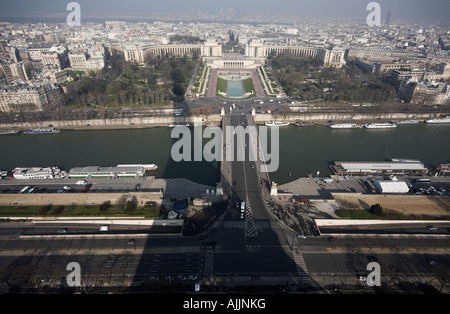 view from top of Eiffel Tower Paris long shadow near mid day - Stock Photo