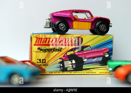 matchbox beach buggy toy car sat on top of original cardboard box  packaging - Stock Photo