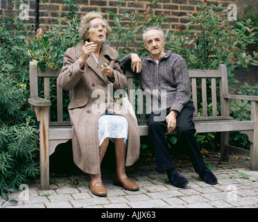 Elderly couple on a bench - Stock Photo