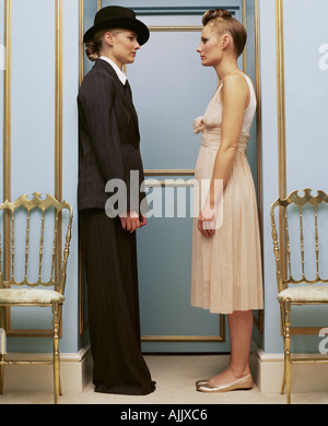 Women in masculine and feminine clothing - Stock Photo