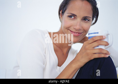 Woman relaxing with a cup of coffee - Stock Photo