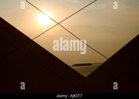 A partial view of the Vembanad Lake through a grid - Stock Photo