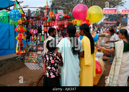 A small child accompanied by her parent casts an eager look at the toys - Stock Photo