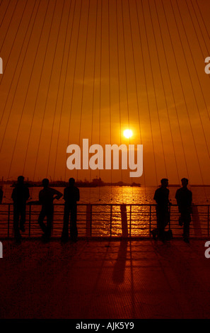 People enjoying the beauty of sunrise in Cochin, Kerala - Stock Photo