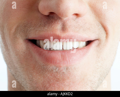 Close-up of man's mouth - Stock Photo