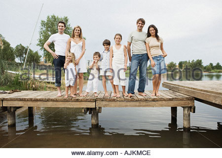 Family and friends standing on a pier - Stock Photo