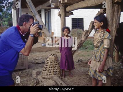 photographer with native childs, Nepal, Himalaya, Khandbari - Stock Photo