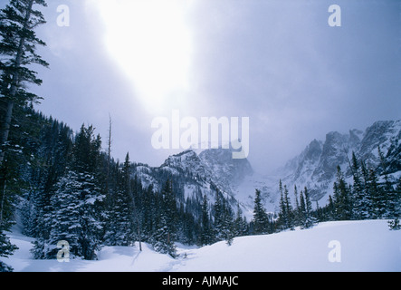 Bright sunlight breaks through heavy cloud cover over Hallett Peak Rocky Mtn Nat l Park CO - Stock Photo