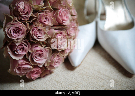 white wedding shoes and flowers - Stock Photo