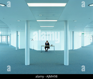 Bored businessman in office - Stock Photo