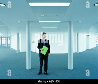 Businessman holding document in office - Stock Photo
