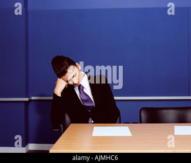 Businesswoman sleeping in office - Stock Photo