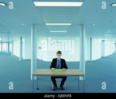 Businessman in an empty office - Stock Photo