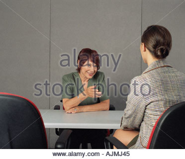 Interviewer asking a question - Stock Photo