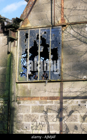Vandalism broken window - Stock Photo