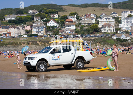 RNLI Beach Lifeguards Rescue vehicles on crowded beach in August Woolacombe Devon UK - Stock Photo